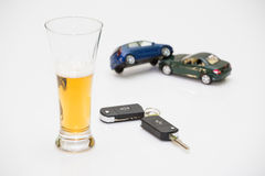 Alcohol and car keys. Glass of alcohol and car keys. Photo isolated on white background Royalty Free Stock Images