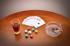Alcohol, cards, dice and cigarette Stock Image