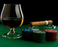 Alcohol, chips and cigar Stock Photography