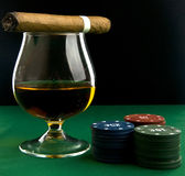 Alcohol, chips and cigar Stock Images