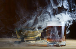Alcohol and cigar. In tobacco smoke Stock Images
