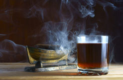 Alcohol and cigar Stock Images
