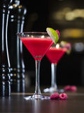 Alcohol cocktail. Raspberry alcohol cocktail on the bar Royalty Free Stock Images