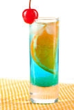 Alcohol cocktail with blue curacao, orange and mar Royalty Free Stock Images