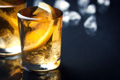 Alcohol cocktail with brandy, whiskey, lemon and ice in small glasses Royalty Free Stock Photo