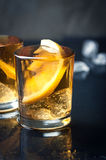 Alcohol cocktail with brandy, whiskey, lemon and ice in small glasses Royalty Free Stock Photography