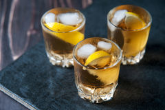 Alcohol cocktail with brandy, whiskey, lemon and ice Royalty Free Stock Image