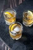 Alcohol cocktail with brandy, whiskey, lemon and ice Royalty Free Stock Photo