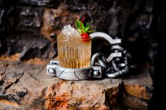 Alcohol cocktail with crushed ice, red cherry and mint. stock image