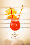 Alcohol cocktail with fruit slices royalty free stock images