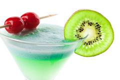 Alcohol cocktail with kiwi and cherry. On in martini glass Stock Image