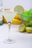 Alcohol cocktail with lime juice Stock Images