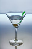 Alcohol cocktail with martini and olive Stock Image