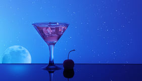Alcohol cocktail in water on night sky background.  Royalty Free Stock Photos