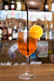 Alcohol cocktail on wooden bar with bar background Royalty Free Stock Photo