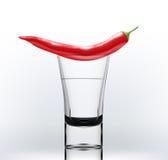 Alcohol con pimienta Fotografía de archivo libre de regalías