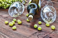 Alcohol, Concept: wine, winemaking, glass, dark, table, wooden, bouquet, burgundy, cabernet, celebration royalty free stock photo