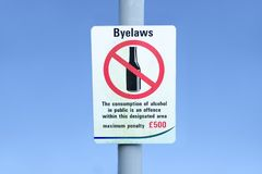 Alcohol consumption public offence fine penalty sign. Uk stock image