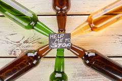 Alcohol dependence concept, wooden table. royalty free stock photo