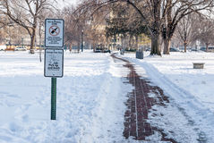 Alcohol and Dog Signs in a city park winter Stock Photography