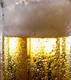 Alcohol drink beer on macro picture with sparkles and foam. Useful for background Royalty Free Stock Photography