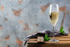 Alcohol drink, beverage, champagne sparkling wine in a flute glass. Food and drink, holidays party concept. Cold fresh alcohol beverage champagne sparkling white stock photography