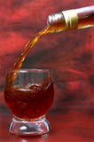 Alcohol drink pouring into glass Royalty Free Stock Photo