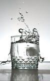 Alcohol drink splashing Stock Photo