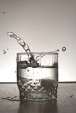 Alcohol drink splashing Royalty Free Stock Photos