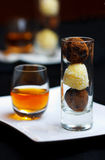 Alcohol drink and truffles Stock Photo