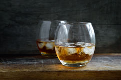 Alcohol drink in two glasses Royalty Free Stock Photos