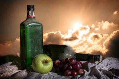 Alcohol drinks with apple and grape. Royalty Free Stock Image
