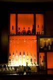 Alcohol drinks in bar. Alcohol drinks on shelves in luxury bar restaurant Stock Photos