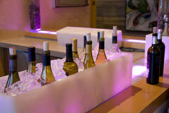 Alcohol drinks bottles in ice in bar restaurant. Variety of alcoholic drinks in a fancy bar restaurant Royalty Free Stock Image