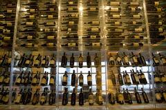 Alcohol drinks bottles on shelves Stock Images