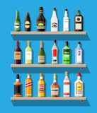 Alcohol drinks collection. Bottles on shelf. Vodka champagne wine whiskey beer brandy tequila cognac liquor vermouth gin rum absinthe sambuca cider bourbon Stock Photography
