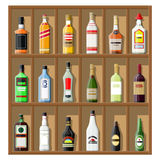 Alcohol drinks collection. Bottles on shelf. Vodka champagne wine whiskey beer brandy tequila cognac liquor vermouth gin rum absinthe sambuca cider bourbon Royalty Free Stock Photo