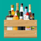 Alcohol drinks collection in box. Bottles with vodka champagne wine whiskey beer brandy tequila cognac liquor vermouth gin rum absinthe sambuca cider bourbon Stock Image