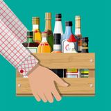 Alcohol drinks collection in box in hand. Bottles with vodka champagne wine whiskey beer brandy tequila cognac liquor vermouth gin rum absinthe sambuca cider royalty free illustration