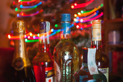 Alcohol drinks. Different alcoholic drinks and christmas lights royalty free stock images