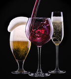 Alcohol drinks set isolated on a black. Background - beer,wine,champagne stock images