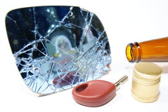 Alcohol and driver. Concept of risk with driving after driving; smash door-mirror from car, key and alcohol Stock Photos