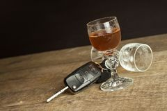 Alcohol and driving. Danger on the roads. Alcoholic behind the wheel. Car keys on the bar. Stock Images