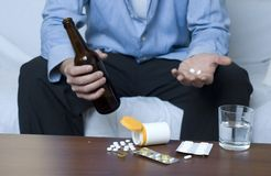 Alcohol and Drugs. Businessman doing mixed use of drugs and alcohol Royalty Free Stock Images