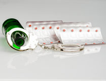 Drug addiction. Alcohol and drugs concept image. Shot on reflection surface Stock Photos