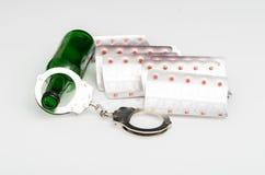 Drug addiction. Alcohol and drugs concept image. Shot on reflection surface Royalty Free Stock Image