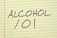 Alcohol 101 en un cojín legal amarillo fotografía de archivo libre de regalías