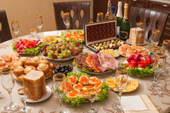Alcohol and food on a table. Royalty Free Stock Images