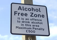 Alcohol Free Zone street sign. A street sign in England stating 'Alcohol Free Zone It is an offence to drink alcohol in this area Maximum Penalty £500 Royalty Free Stock Image
