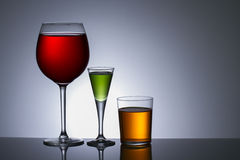Alcohol in glass. Three Colors of alcohol in glass Royalty Free Stock Image
